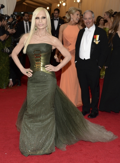 """FILE - In this May 5, 2014, file photo, Donatella Versace attends The Metropolitan Museum of Art's Costume Institute benefit gala celebrating """"Charles James: Beyond Fashion"""" in New York. The Met announced on Nov. 8, 2017, that Versace, Rihanna, Amal Clooney and Anna Wintour will serve as co-chairs of next year's Met Gala. (Photo by Evan Agostini/Invision/AP, File)"""
