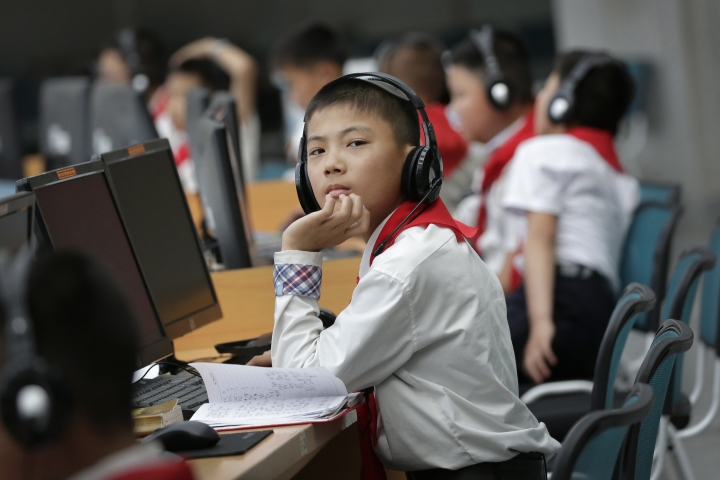 In this June 16, 2017, photo, North Korean students use computer terminals at the Sci-Tech Complex in Pyongyang, North Korea. Ever so cautiously, North Korea is going online. This is all done with a two-tiered system where the trusted elite can surf with relative freedom while the masses are kept inside the national intranet, painstakingly sealed off from the outside world and meticulously surveilled. (AP Photo/Wong Maye-E)