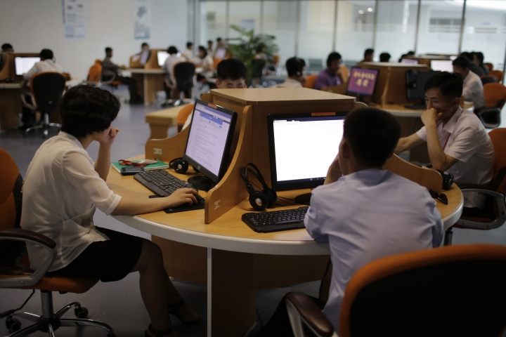 In this June 16, 2017, photo, North Korean men and women use computer terminals at the Sci-Tech Complex in Pyongyang, North Korea. Ever so cautiously, North Korea is going online. This is all done with a two-tiered system where the trusted elite can surf with relative freedom while the masses are kept inside the national intranet, painstakingly sealed off from the outside world and meticulously surveilled. (AP Photo/Wong Maye-E)