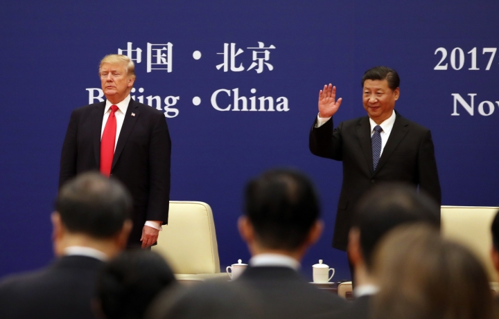 U.S. President Donald Trump, left, and Chinese President Xi Jinping attend a business event at the Great Hall of the People in Beijing, Thursday, Nov. 9, 2017. (AP Photo/Andrew Harnik)