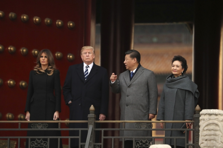 President Donald Trump, center left, first lady Melania Trump, left, accompanied by Chinese President Xi Jinping, center right, and his wife Peng Liyuan, right, tour the Forbidden City, Wednesday, Nov. 8, 2017, in Beijing, China. Trump is on a five country trip through Asia traveling to Japan, South Korea, China, Vietnam and the Philippines. (AP Photo/Andrew Harnik)