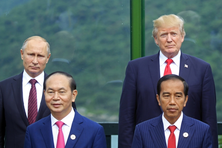 Back left to right; Russian President Vladimir Putin, and U.S. President Donald Trump, front row left to right; Vietnamese President Tran Dai Quang, and Indonesian President Joko Widodo pose for a photo during the family photo session during the Asia-Pacific Economic Cooperation (APEC) Summit in Danang, Vietnam, Saturday, Nov. 11, 2017. (AP Photo/Hau Dinh)