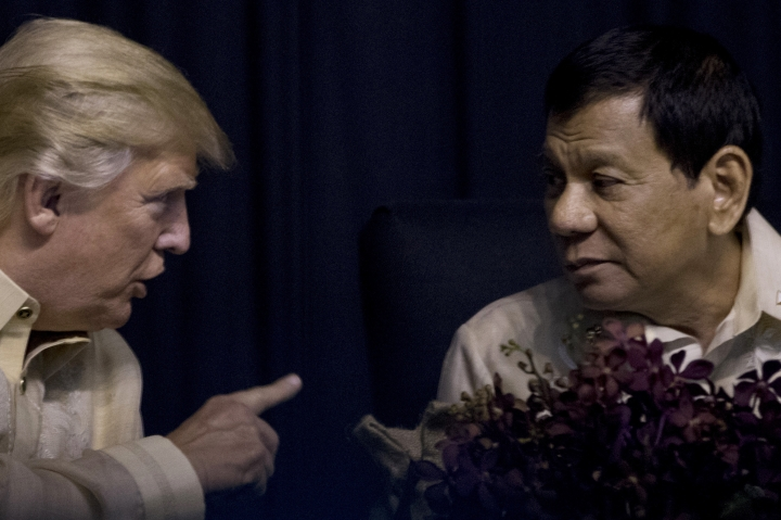 President Donald Trump speaks with Philippines President Rodrigo Duterte at an ASEAN Summit dinner at the SMX Convention Center, Sunday, Nov. 12, 2017, in Manila, Philippines. (AP Photo/Andrew Harnik)