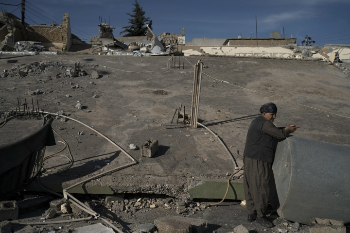 A man stands next to a destroyed house after an earthquake in the city of Darbandikhan, northern Iraq, Monday, Nov. 13, 2017. Authorities reported that a powerful 7.3 magnitude earthquake struck the Iraq-Iran border region on Monday and killed more than three hundred people in both countries, sent people fleeing their homes into the night and was felt far west as the Mediterranean coast. (AP Photo/Felipe Dana)