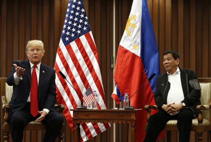 U.S. President Donald Trump, left, gestures beside Philippine President Rodrigo Duterte as they hold a bilateral meeting on the sidelines of the 31st Association of Southeast Asian Nations (ASEAN) Summit and Related Meetings at the Philippine International Convention Center in Manila, Philippines Monday Nov. 13, 2017. (Rolex dela Pena/Pool Photo via AP)
