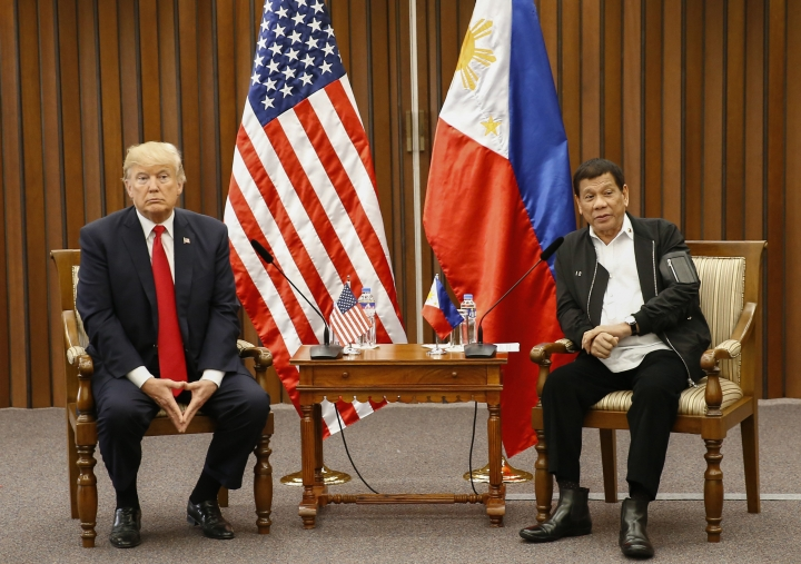 U.S. President Donald Trump, left, and Philippine President Rodrigo Duterte hold a bilateral meeting on the sidelines of the 31st Association of Southeast Asian Nations (ASEAN) Summit and Related Meetings at the Philippine International Convention Center in Manila, Philippines Monday Nov. 13, 2017. (Rolex dela Pena/Pool Photo via AP)