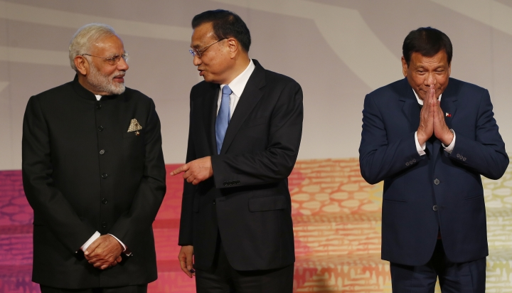 Indian Prime Minister Narendra Modi, left, and Chinese Premier Li Keqiang, chat as Philippine President Rodrigo Duterte gestures, following a photo session for the East Asia Summit at the ongoing 31st ASEAN Summit Tuesday, Nov. 14, 2017 in Manila, Philippines. (AP Photo/Bullit Marquez, Pool)