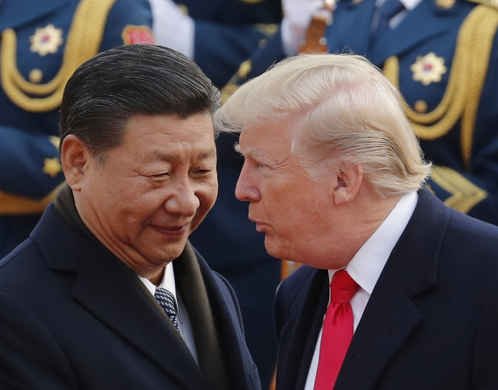 FILE - In this Nov. 9, 2017, file photo, U.S. President Donald Trump, right, chats with Chinese President Xi Jinping during a welcome ceremony at the Great Hall of the People in Beijing. Following Trump's visit to Beijing, China says it's sending a high-level special envoy to North Korea amid an extended chill in relations between the neighbors over Pyongyang's nuclear weapons and missile programs. The official Xinhua News Agency said Wednesday, Nov. 15, 2017, that director of the ruling Communist Party's International Liaison Department, Song Tao, would travel to Pyongyang on Friday to report on the party's national congress held in October. (AP Photo/Andy Wong, File)
