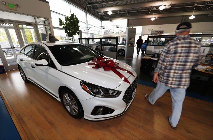 FILE - In this Friday, Oct. 6, 2017, file photo, a buyer walks past a 2018 Sonata sitting amid an assortment of models on the showroom floor of a Hyundai dealership in the south Denver suburb of Littleton, Colo. Black Friday has become one of the single best days of the year to buy a car. According to Edmunds research, 15 percent of total November car sales take place on Black Friday weekend. (AP Photo/David Zalubowski, File)
