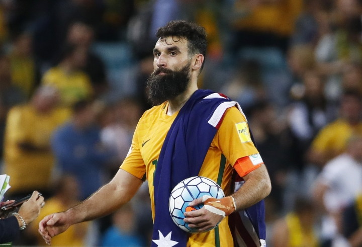 Australia's Mile Jedinak takes the ball after scoring a hat-trick to defeat Honduras during their World Cup soccer playoff deciding match in Sydney, Australia, Wednesday, Nov. 15, 2017. (AP Photo/Daniel Munoz)
