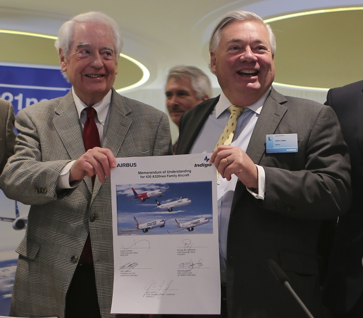 Bill Franke, managing partner of Indigo Partners, left, and John Leahy, chief operating officer – Customers of Airbus, hold a memorandum of understanding after an Airbus announcement in Dubai, United Arab Emirates, Wednesday, Nov. 15, 2017. Airbus signed a $49.5 billion deal on Wednesday to sell 430 airplanes to the Phoenix-based private equity firm that owns Frontier Airlines, striking the European aerospace company's biggest deal ever at the Dubai Air Show. (AP Photo/Kamran Jebreili)