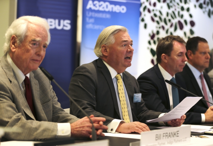 From left to right, Bill Franke, managing partner of Indigo Partners, John Leahy, chief operating officer – Customers of Airbus, Jozsef Varadi, chief executive officer of Wizz Air, and Enrique Beltranena, founder and CEO of Volaris, take part in an Airbus announcement in Dubai, United Arab Emirates, Wednesday, Nov. 15, 2017. Airbus signed a $49.5 billion deal on Wednesday to sell 430 airplanes to the Phoenix-based private equity firm that owns Frontier Airlines, striking the European aerospace company's biggest deal ever at the Dubai Air Show. (AP Photo/Kamran Jebreili)