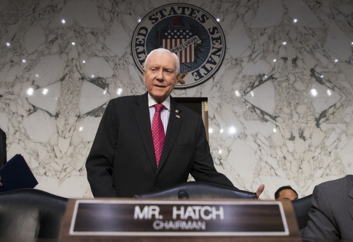 "In this Nov. 13, 2017, photo, Senate Finance Committee Chairman Orrin Hatch, R-Utah, arrives as the tax-writing panel begins work on overhauling the nation's tax code, on Capitol Hill in Washington. Millions would forgo coverage if Congress repeals the unpopular requirement that Americans get health insurance, gambling with their own wellbeing and boosting premiums for others. Just as important, the drive by GOP senators to undo ""Obamacare's"" coverage requirement fits in with Trump administration efforts to write regulations allowing for plans with limited benefits and lower premiums. (AP Photo/J. Scott Applewhite, File)"