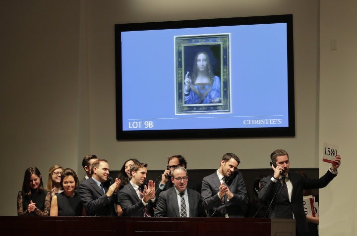 "Bidding representatives react after Leonardo da Vinci's ""Salvator Mundi"" sold for $400 million at Christie's, Wednesday, Nov. 15, 2017, in New York. (AP Photo/Julie Jacobson)"