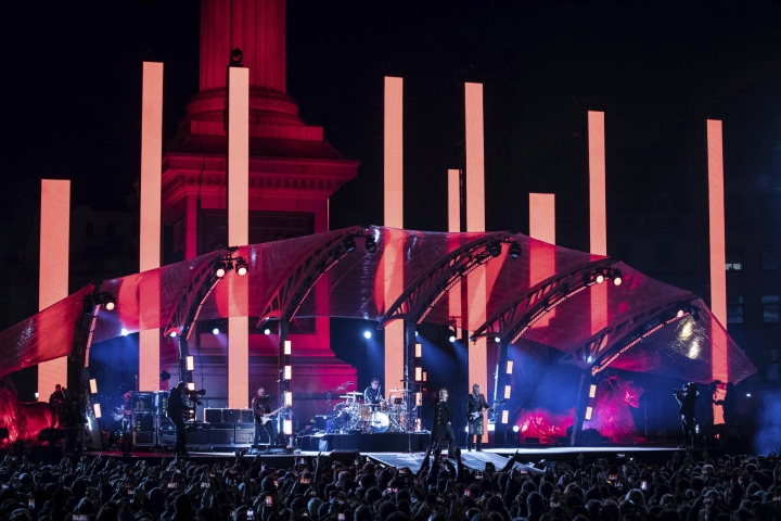 Musicians U2 perform on stage in Trafalgar Square ahead of the 2017 MTV Europe Music Awards, in London, Saturday, Nov. 11, 2017. (Photo by Vianney Le Caer/Invision/AP)
