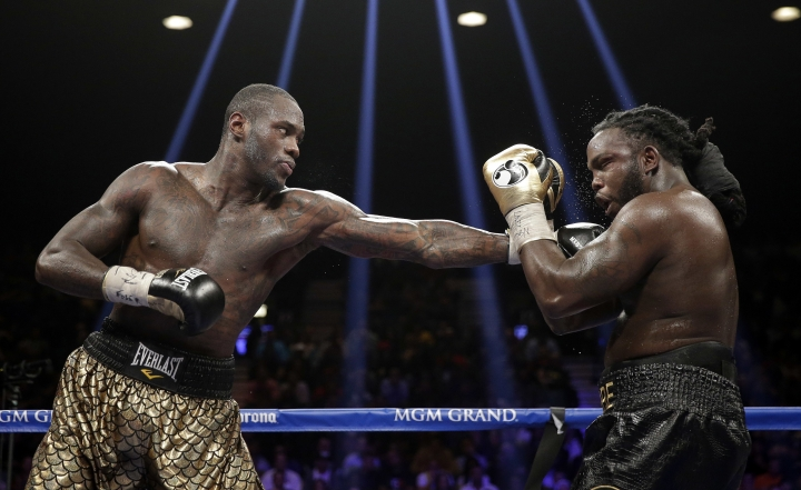 FILE - In this Jan. 17, 2015, file photo, Deontay Wilder, left, punches Bermane Stiverne during their WBC heavyweight championship boxing match in Las Vegas. Wilder, the WBC heavyweight champion, will square off again against Stiverne on Saturday night at Barclays Center. Wilder is 38-0 with 37 knockouts. The only opponent who went the distance with him is Stiverne. (AP Photo/Isaac Brekken, File)