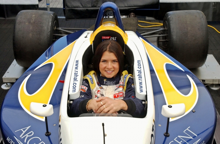 FILE - In this June 14, 2003, file photo, race car driver Danica Patrick poses inside her car at the Laguna Seca Raceway in Monterey, Calif. Patrick announced plans Friday, Nov. 17, 2017, to run just 2 races in 2018, the Daytona 500 and the Indianapolis 500, and end her full-time driving career. (AP Photo/Marcio Jose Sanchez, File)