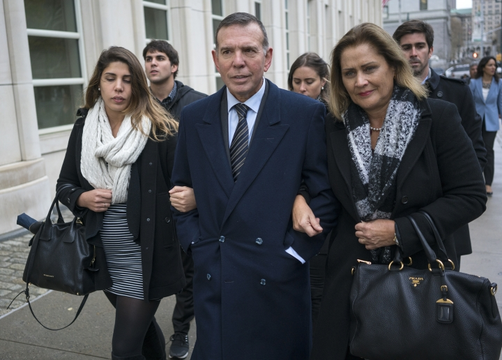 Juan Angel Napout, center, arrives at federal court in the Brooklyn borough of New York, Thursday, Nov. 16, 2017. He is one of three former South American soccer officials who are going on trial in a U.S. case highlighting widespread corruption in the sport's governing body. (AP Photo/Craig Ruttle)