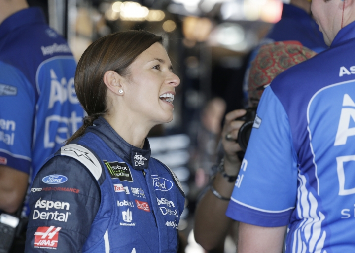 Danica Patrick smiles in the garage during practice for Sunday's NASCAR Cup Series auto race at Homestead-Miami Speedway in Homestead, Fla., Friday, Nov. 17, 2017.(AP Photo/Terry Renna)