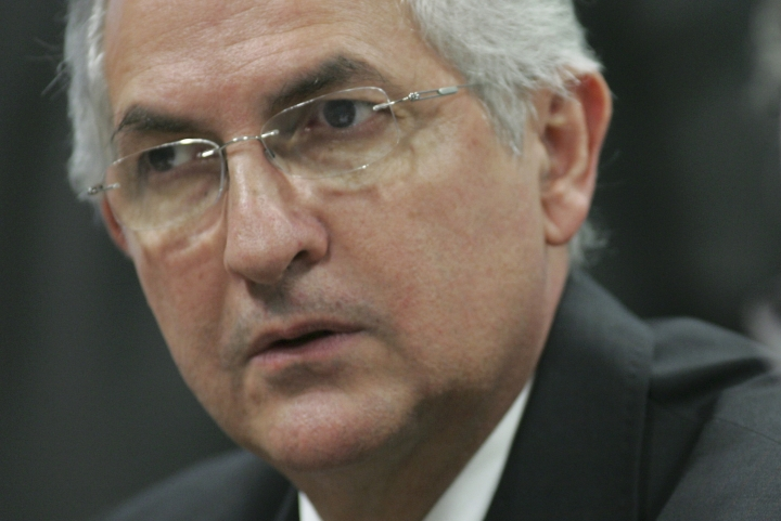 FILE - In this Oct. 27, 2009 file photo, Caracas' Mayor Antonio Ledezma attends a Senate meeting, in Brasilia, Brazil. The former mayor has escaped house arrest in Caracas and arrived in Colombia, Friday, Nov. 17, 2017. (AP Photo/Eraldo Peres, File)
