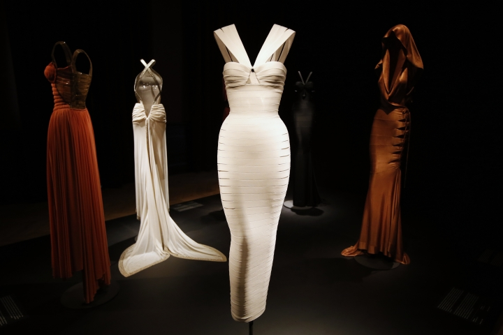 FILE - In this Sept. 25, 2013 file photo, creations by French Tunisian born Fashion designer Azzedine Alaia are presented for the first Paris retrospective of couturier during the reopening of the Galliera Museum in Paris. Alaia, a fashion iconoclast whose clingy styles helped define the 1980s and who dressed famous women from Hollywood to the White House, has died at age 77. The French Haute Couture Federation announced Alaia's death on Saturday, Nov. 18, 2017 without providing details. (AP Photo/Francois Mori)