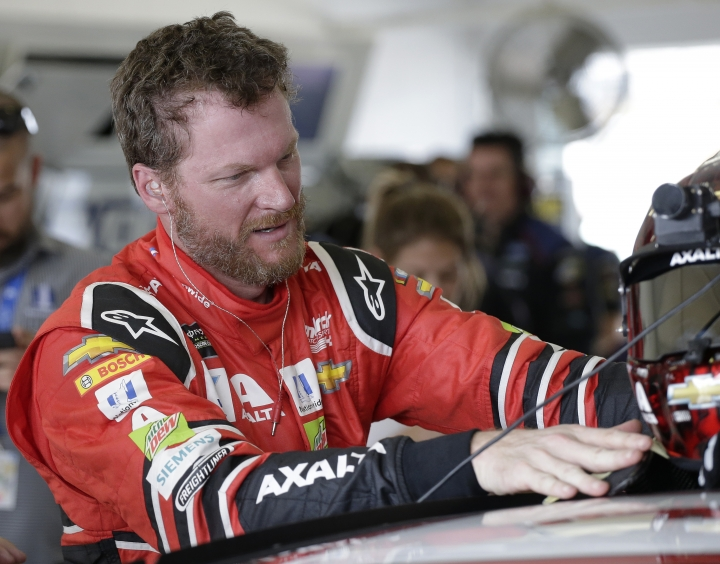 Dale Earnhardt Jr. exits his car after practice for Sunday's NASCAR Cup Series auto race at Homestead-Miami Speedway in Homestead, Fla., Saturday, Nov. 18, 2017.(AP Photo/Terry Renna)