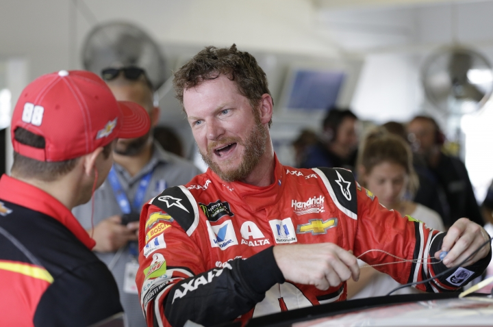 Dale Earnhardt Jr. shares a laugh with a crew member after practice for Sunday's NASCAR Cup Series auto race at Homestead-Miami Speedway in Homestead, Fla., Saturday, Nov. 18, 2017.(AP Photo/Terry Renna)