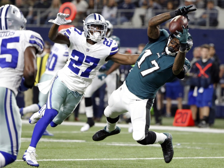 Dallas Cowboys cornerback Jourdan Lewis (27) defends as Philadelphia Eagles wide receiver Alshon Jeffery (17) catches a pass for a touchdown in the second half of an NFL football game, Sunday, Nov. 19, 2017, in Arlington, Texas. (AP Photo/Michael Ainsworth)
