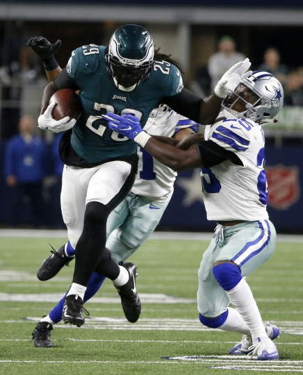 Philadelphia Eagles running back LeGarrette Blount (29) breaks a tackle attempt by Dallas Cowboys' Xavier Woods (25) as LeGarrette carries the ball for long yardage in the second half of an NFL football game, Sunday, Nov. 19, 2017, in Arlington, Texas. (AP Photo/Michael Ainsworth)