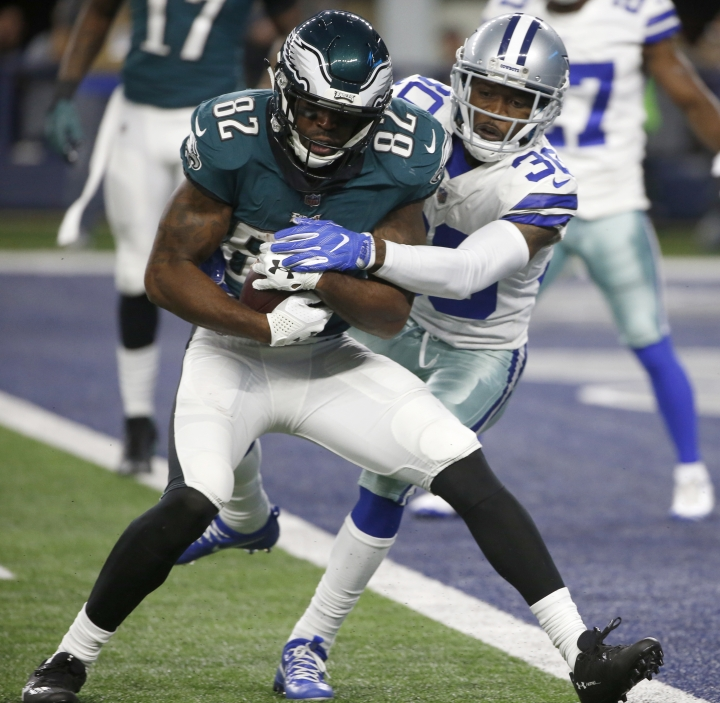 Philadelphia Eagles wide receiver Torrey Smith (82) catches a pass or a touchdown as Dallas Cowboys' Anthony Brown (30) defends in the second half of an NFL football game, Sunday, Nov. 19, 2017, in Arlington, Texas. (AP Photo/Ron Jenkins)