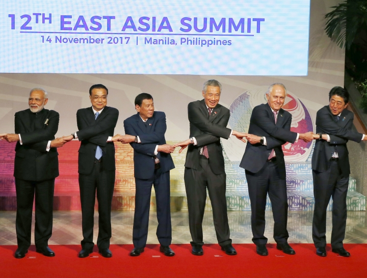 "FILE - In this Nov. 14, 2017, file photo, Chinese Premier Li Keqiang, second from left, links hands with other leaders from the ASEAN and their Dialogue Partners which comprises the East Asia Summit, for a group photo session at the 31st ASEAN Summit in Manila, Philippines. Leaders of Southeast Asian countries and China have agreed to launch talks on a ""code of conduct"" aimed at controlling disputes in the South China Sea, a step they described as a milestone, but which some experts said was unlikely to bring concrete results. (AP Photo/Bullit Marquez, Pool, File)"