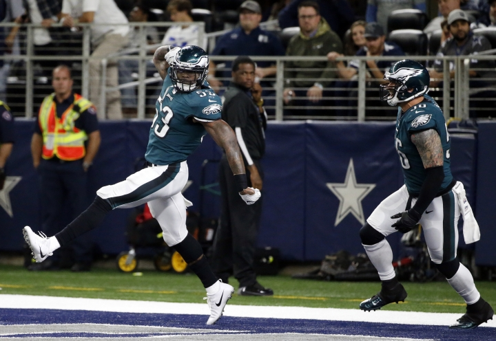 Philadelphia Eagles linebacker Nigel Bradham (53) and Chris Long (56) celebrate a touchdown scored by Bradham after Bradham recovered a Dallas Cowboys' Dak Prescott fumble in the second half of an NFL football game, Sunday, Nov. 19, 2017, in Arlington, Texas. (AP Photo/Michael Ainsworth)