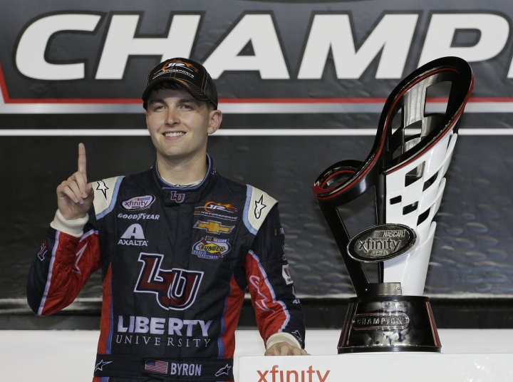 William Byron poses with his trophy in Victory Lane after winning the NASCAR Xfinity Series auto racing championship at Homestead-Miami Speedway in Homestead, Fla., Saturday, Nov. 18, 2017.(AP Photo/Terry Renna)