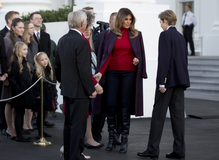 First lady Melania Trump with her son Barron Trump, right, greet the Chapman family of Silent Night Evergreens, who presented them the Wisconsin-grown Christmas Tree at the North Portico of the White House in Washington, Monday, Nov. 20, 2017. The tree will be displayed in the White House Blue Room. (AP Photo/Manuel Balce Ceneta)