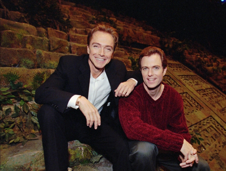 """FILE - In this Nov. 11, 1997, file photo, David Cassidy, left, and brother Patrick sit on the stage of EFX at the MGM Grand in Las Vegas. Former teen idol Cassidy of """"The Partridge Family"""" fame has died at age 67, publicist said Tuesday, Nov. 21, 2017. (AP Photo/Jack Dempsey, File)"""