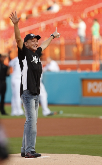 """FILE - In this July 9, 2011, file photo, actor David Cassidy acknowledges the crowd before throwing out a ceremonial first pitch before a baseball game between the Florida Marlins and the Houston Astros, in Miami. Former teen idol Cassidy of """"The Partridge Family"""" fame has died at age 67, publicist said Tuesday, Nov. 21, 2017. (AP Photo/Wilfredo Lee, File)"""