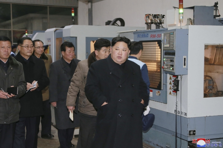 """In this undated photo provided on Tuesday, Nov. 21, 2017, by the North Korean government, North Korean leader Kim Jong Un visits the the Sungri Motor Complex in Pyeongannam-do, North Korea. The Trump administration is due to announce new sanctions on North Korea on Tuesday, Nov. 21, 2017, after declaring it a state sponsor of terrorism in the latest push to isolate the pariah nation. Independent journalists were not given access to cover the event depicted in this image distributed by the North Korean government. The content of this image is as provided and cannot be independently verified. Korean language watermark on image as provided by source reads: """"KCNA"""" which is the abbreviation for Korean Central News Agency. (Korean Central News Agency/Korea News Service via AP)"""