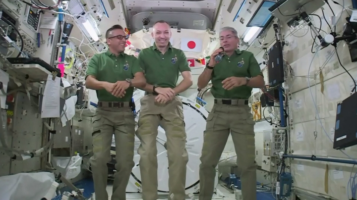 In this undated image provided by NASA, NASA astronauts Joe Acaba, left, Randy Bresnik, center, and Mark Vande Hei give interviews on the International Space Station. The trio along with their international crewmates plan to feast on pouches of Thanksgiving turkey and single-serving bags of sides on Thursday, Nov. 23, 2017. (NASA via AP)