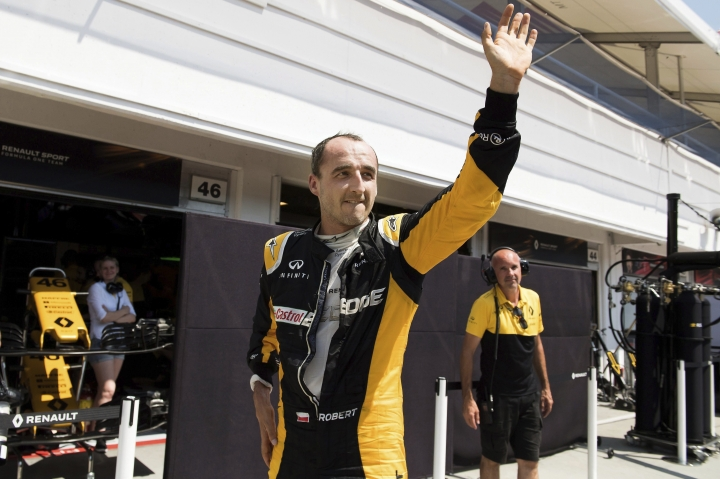 FILE - This is a Wednesday, Aug. 2, 2017 file photo of former Formula One driver Robert Kubica of Poland participates in a test session for Team Renault on the Hungaroring circuit in Mogyorod, 23 kms north-east of Budapest, Hungary. After nearly losing his right hand, Kubica could be gripping a Formula One steering wheel with it next year. (Szilard Koszticsak/MTI via AP, File )