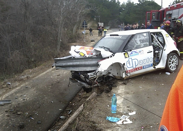 "FILE - This Feb. 6, 2011, file photo shows a piece of guard rail through the wrecked Skoda car of Polish Formula One driver Robert Kubica after a crash during the rally ""Ronde di Andora"" in Andora, Italy. After nearly losing his right hand, Robert Kubica could be gripping a Formula One steering wheel with it next year. (AP Photo/Gianni Chiaramonti, File)"