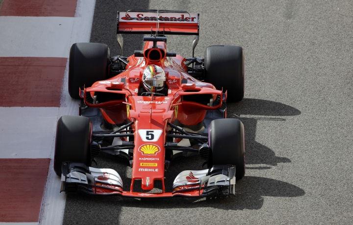 Ferrari driver Sebastian Vettel of Germany steers his car during the first free practice at the Yas Marina racetrack in Abu Dhabi, United Arab Emirates, Friday, Nov. 24, 2017. The Emirates Formula One Grand Prix will take place on Sunday. (AP Photo/Luca Bruno)