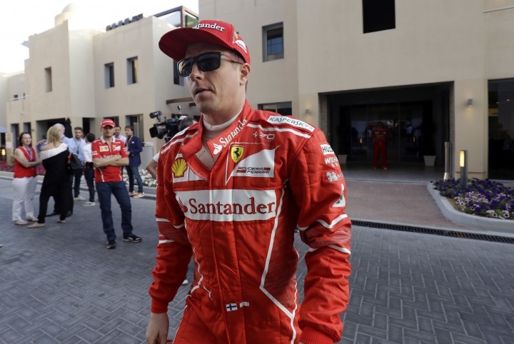 Ferrari driver Kimi Raikkonen of Finland walks in the paddock before the second free practice at the Yas Marina racetrack in Abu Dhabi, United Arab Emirates, Friday, Nov. 24, 2017. The Emirates Formula One Grand Prix will take place on Sunday. (AP Photo/Luca Bruno)