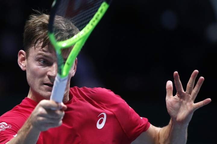 Belgium's David Goffin returns the ball to France's Lucas Pouille during their Davis Cup final single match at the Pierre Mauroy stadium in Lille, northern France, Friday, Nov. 24, 2017. (AP Photo/Michel Spingler)