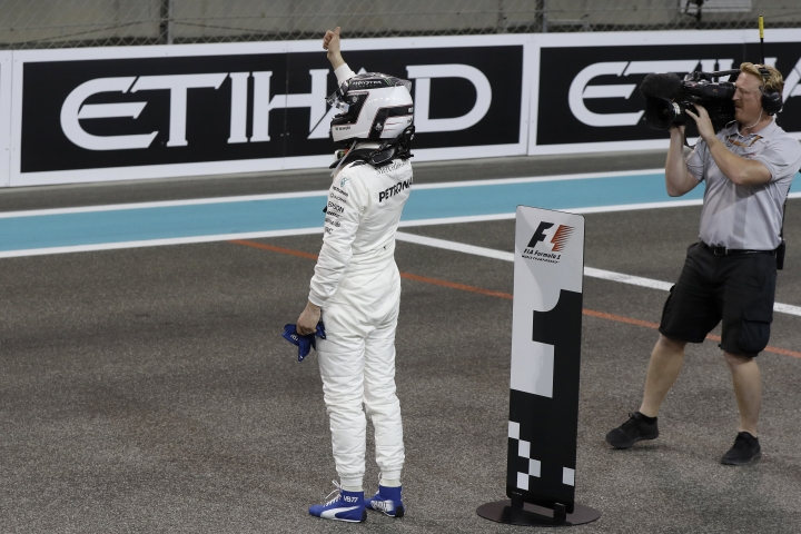 Mercedes driver Valtteri Bottas, of Finland, celebrates after setting the pole position during the qualifying session at the Yas Marina racetrack in Abu Dhabi, United Arab Emirates, Saturday, Nov. 25, 2017. The Emirates Formula One Grand Prix will take place on Sunday. (AP Photo/Luca Bruno)