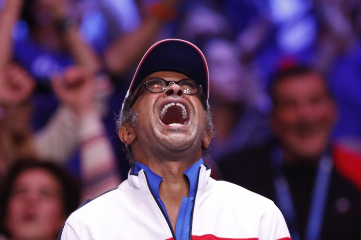France's captain Yannick Noah celebrates as Belgium's Steve Darcis plays France's Lucas Pouille during their Davis Cup final single match at the Pierre Mauroy stadium in Lille, northern France, Sunday, Nov.26, 2017. (AP Photo/Christophe Ena)