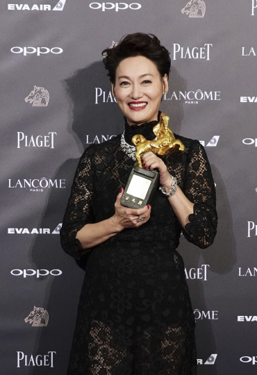 "Hong Kong actress Kara Wai holds her awards and poses for media for Best The Best Leading Actress at the 54th Golden Horse Awards in Taipei, Taiwan, Saturday, Nov. 25, 2017. Wai won for the film ""The Bold, The Corrupt, and The Beautifu"" at this year's Golden Horse Awards -the Chinese-language film industry's biggest annual events. (AP Photo/ Billy Dai)"