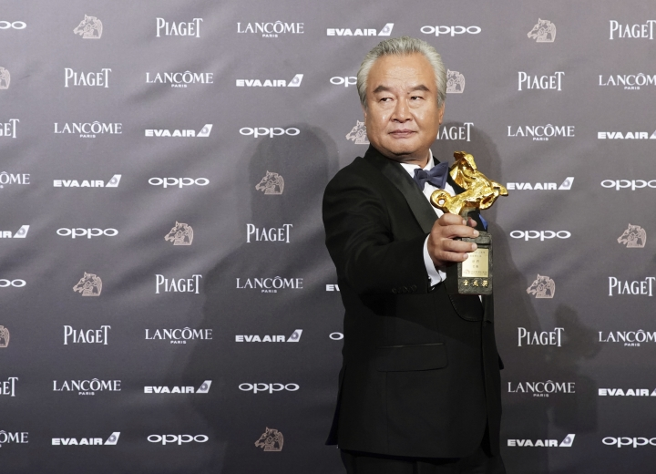 """Chinese actor Tu Men arrives at the 54th Golden Horse Awards in Taipei, Taiwan, Saturday, Nov. 25, 2017. Tu is nominated for Best Leading Actor for the film """"Old Beast"""" at this year's Golden Horse Awards -one of the Chinese-language film industry's biggest annual events. (AP Photo/ Billy Dai)"""