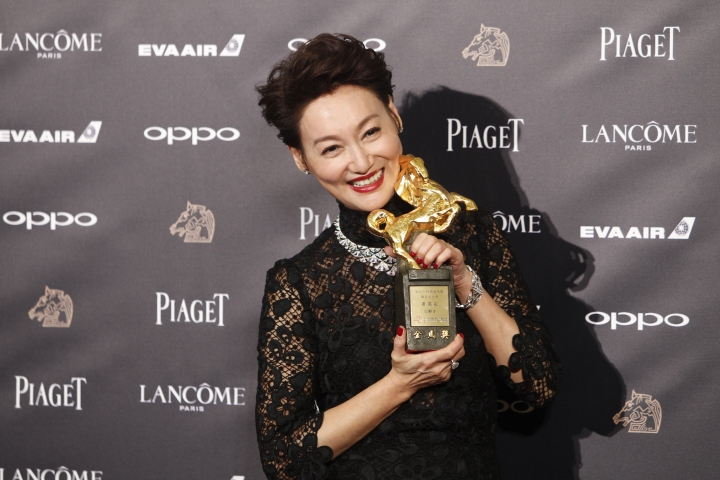 """Hong Kong actress Kara Wai holds her awards and poses for media for Best The Best Leading Actress at the 54th Golden Horse Awards in Taipei, Taiwan, Saturday, Nov. 25, 2017. Wai won for the film """"The Bold, The Corrupt, and The Beautifu"""" at this year's Golden Horse Awards -the Chinese-language film industry's biggest annual events.(AP Photo/Chiang Ying-ying)"""