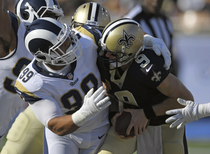 New Orleans Saints quarterback Drew Brees, right, gets sacked by Los Angeles Rams defensive end Aaron Donald during the first half of an NFL football game, Sunday, Nov. 26, 2017, in Los Angeles. (AP Photo/Mark J. Terrill)