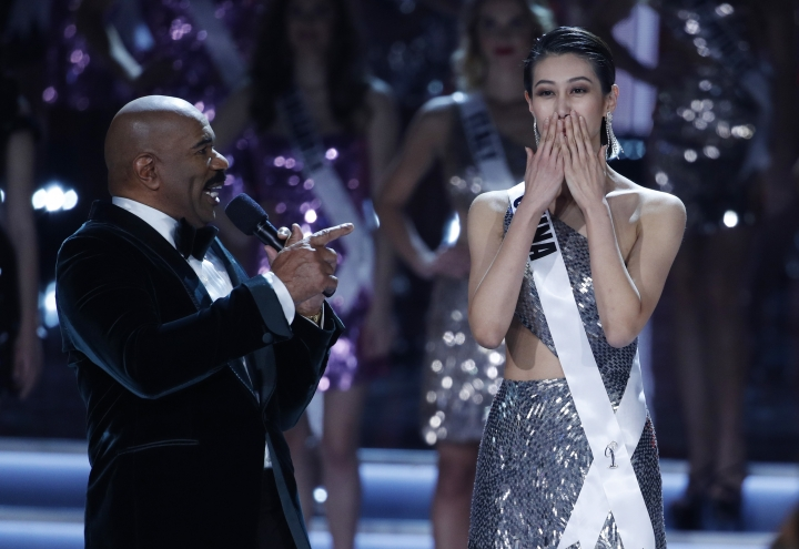 Miss China Roxette Qiu reacts as she is interviewed by Steve Harvey at the Miss Universe pageant Sunday, Nov. 26, 2017, in Las Vegas. (AP Photo/John Locher)